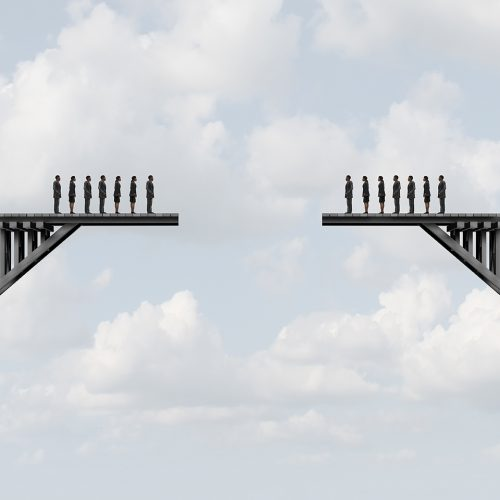 people standing on either side of gap in a bridge